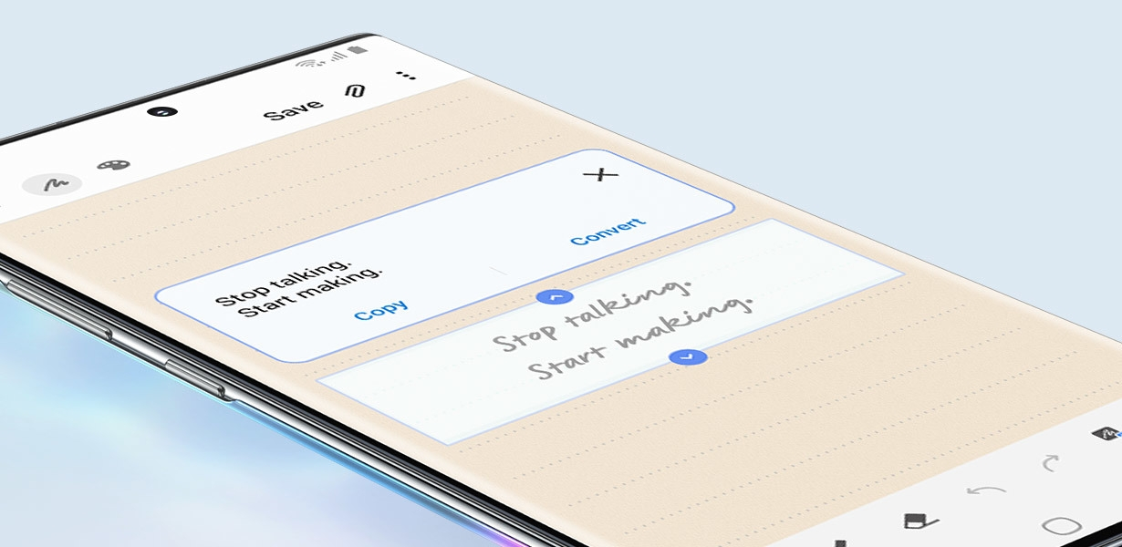 Close up of Galaxy Note10 plus screen and blue S Pen writing Stop talking Start making. The image pulls out to reveal the full phone and the handwriting is turned into text, demonstrating the Text Export feature
